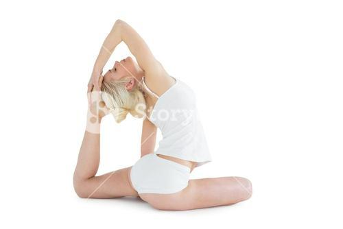 Toned young woman doing the pigeon pose