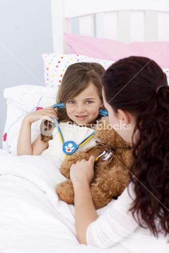 Mother and daughter playing with a stethoscope