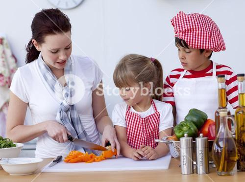 Children helping mother cooking in the kitchen