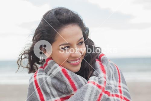 Close up of a woman covered with blanket at beach