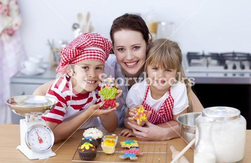 Mother and children baking in the kitchen