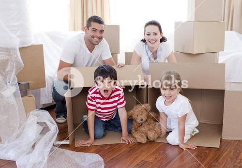 Family moving house with boxes around