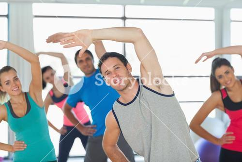 People doing power fitness exercise at yoga class
