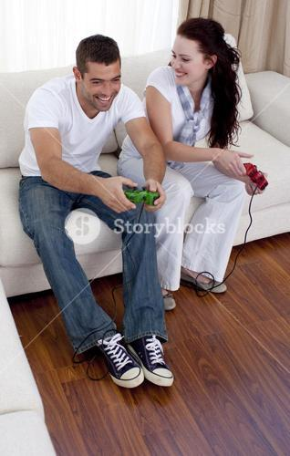 Frineds playing video games in livingroom