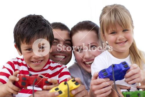 Portrait of family playing video games at home