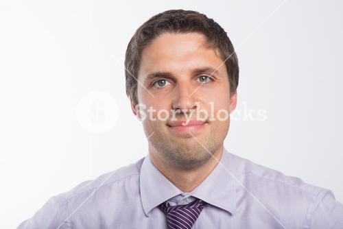 Closeup portrait of a green eyed businessman