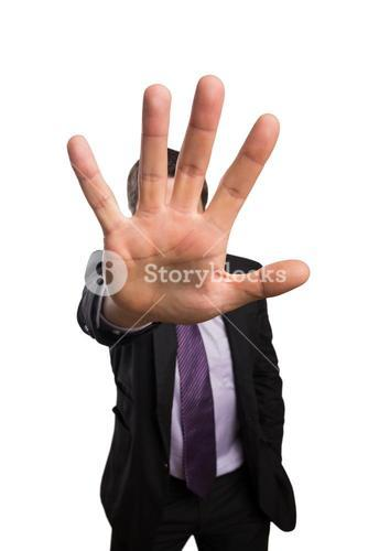 Young businessman with stop gesture