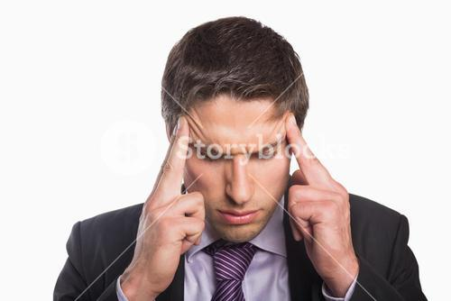 Tensed businessman suffering from headache