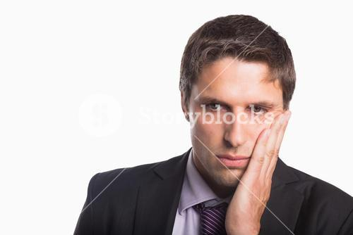Closeup of a young worried businessman