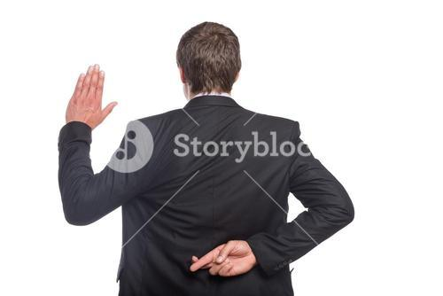 Businessman with crossed fingers and stop gesture