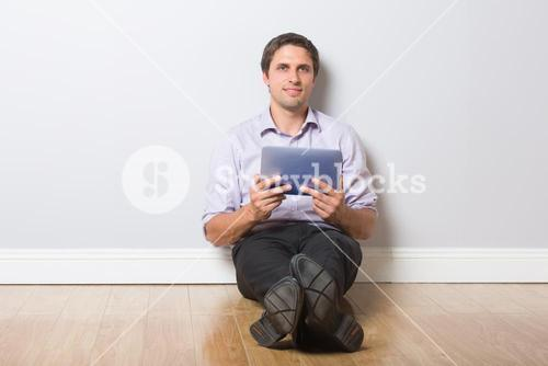 Businessman with digital tablet in an empty room