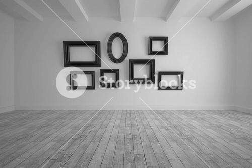 Big room with several frames at wall