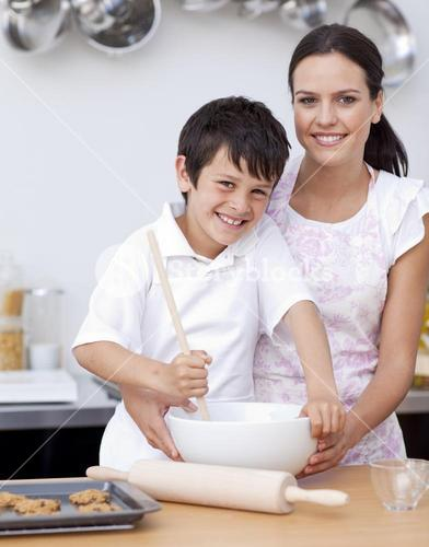 Mother and son baking in the kitchen