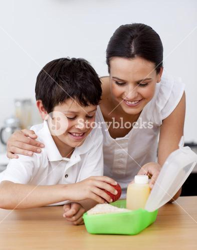 Mother and son making the school lunch