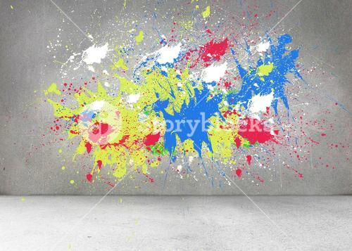 Splashes of color on grey wall