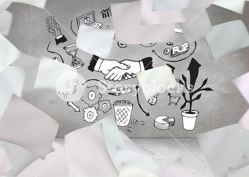 Papers in front of grey wall with graphics