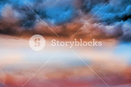 Blue orange cloudy sky background