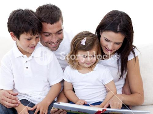 Portrait of a lovely family reading a book