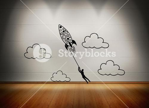 Rocket with man at white wall in room
