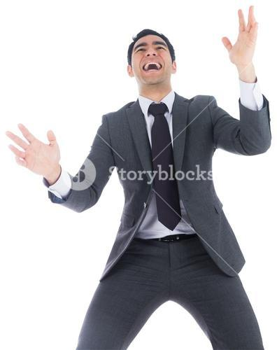 Excited businessman catching