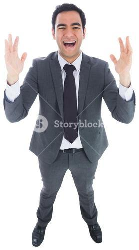 Excited businessman with arms raised