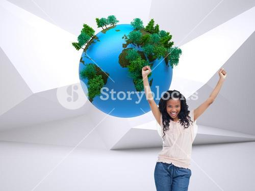 Composite image of a happy woman with her hands in the air