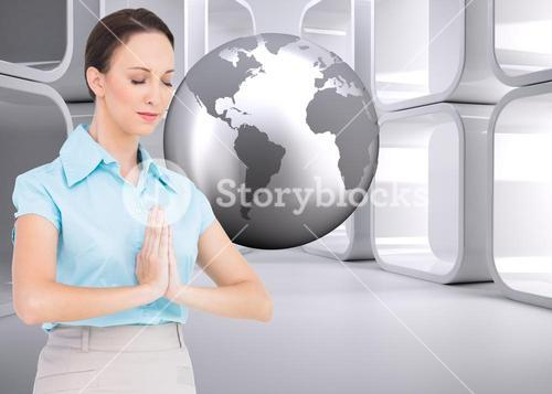 Composite image of peaceful businesswoman praying