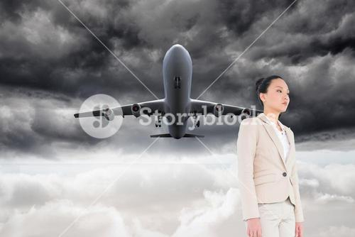 Composite image of unsmiling businesswoman walking