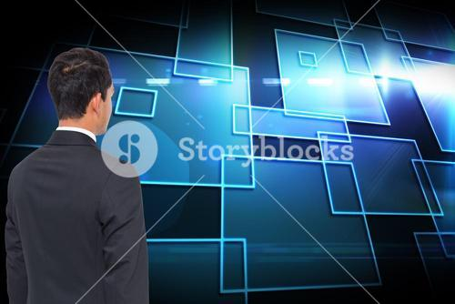 Composite image of shiny squares with businessman