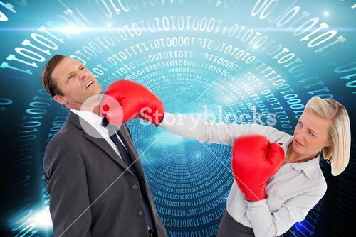Composite image of businesswoman hitting colleague