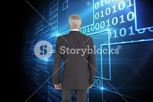 Composite image of businessman walking away