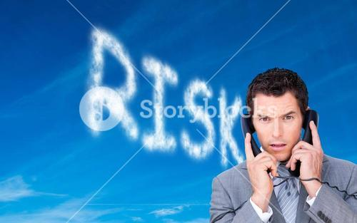 Composite image of businessman tangled up in phone wires