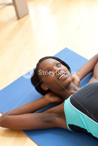 Radiant woman in gym outfit excercising