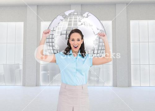 Composite image of victorious businesswoman posing