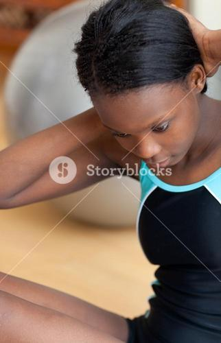 Attractive woman in gym outfit doing situps