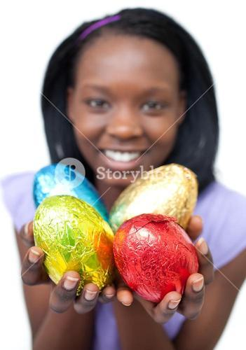 Happy woman showing Easter eggs
