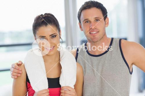 Closeup portrait of a fit couple in exercise room