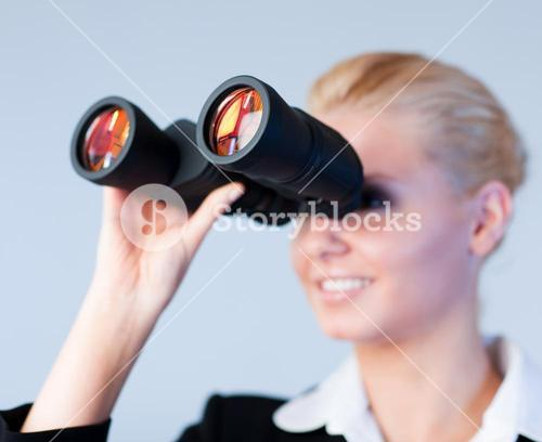Busines woman looking through Binoculars