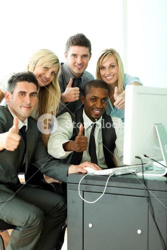 International business team working in office with thumbs up