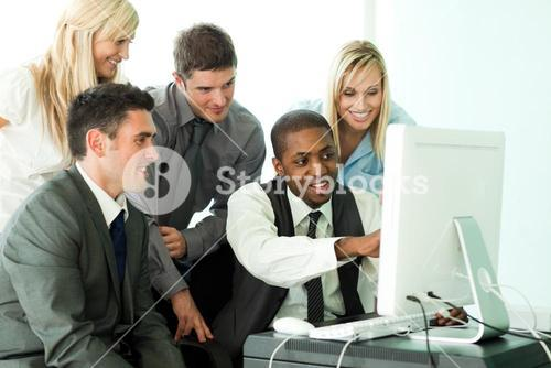 Businessman explaining a job to his team in office