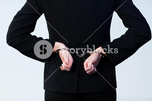 Business person handcuffed