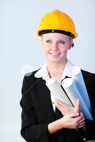 female constrcution worker with blueprints