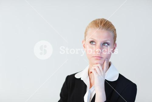 Business woman contemplating