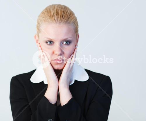 Woman with hands on her face