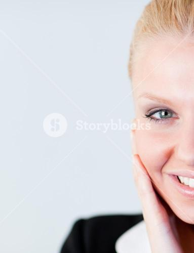 Woman with hand on her face