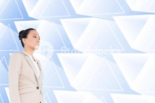 Composite image of unsmiling asian businesswoman walking