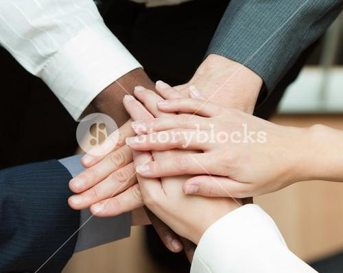 Close up of hands together. Concept of union in business