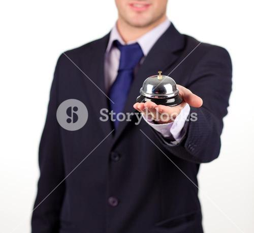 waiter holding a hotel bell