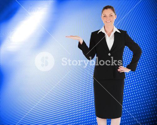 Composite image of charming woman in suit showing a copy space