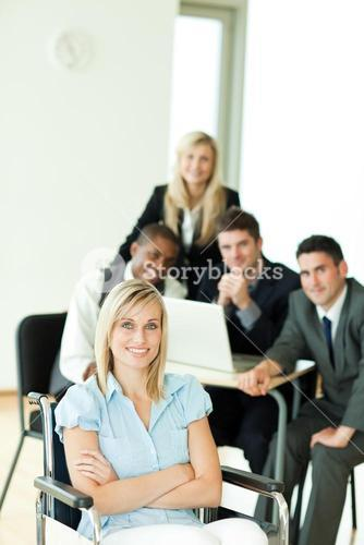 Businesswoman with her group working in the background